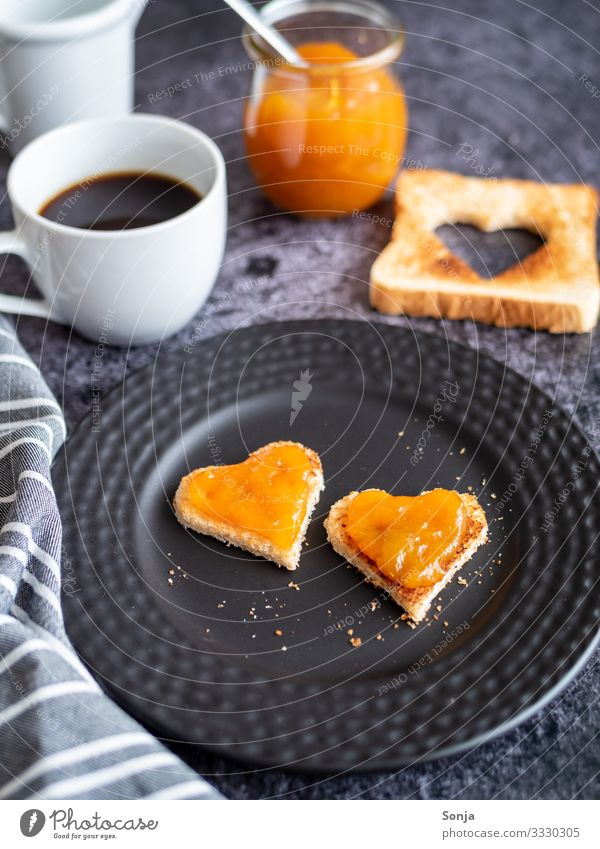 Breakfast with heart-shaped toast and apricot jam Food Bread Jam Toast Nutrition To have a coffee Beverage Hot drink Coffee Plate Cup Glass Table