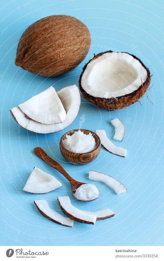 Coconut oil in a bowl with a spoon Vegetable Nutrition Vegetarian diet Diet Bowl Spoon Blue Brown White keto coconut oil Ingredients Light blue Vegan diet
