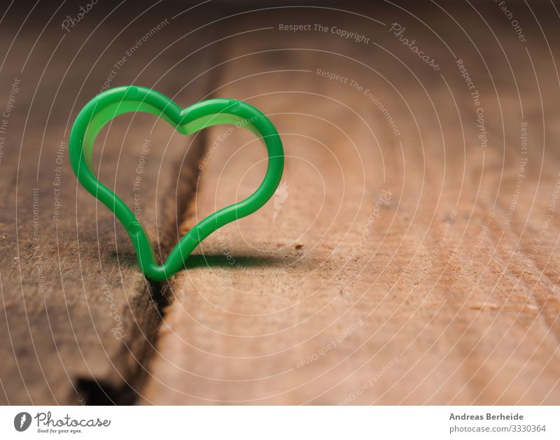 Small green heart shape on a rustic wooden table Style Valentine's Day Mother's Day Birthday Sign Heart Love Retro Sympathy Friendship conceptual Single frame