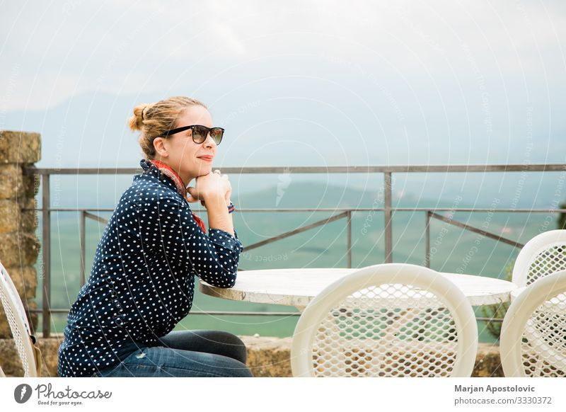 Young woman on a terrace with a beautiful view Lifestyle Joy Vacation & Travel Tourism Table Restaurant Human being Feminine Youth (Young adults) Woman Adults 1