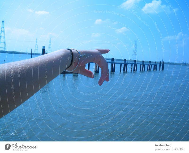 Showing the arm Ocean Schelde Fingers Clouds Woman Poverty Wharf Water bracelet Blue