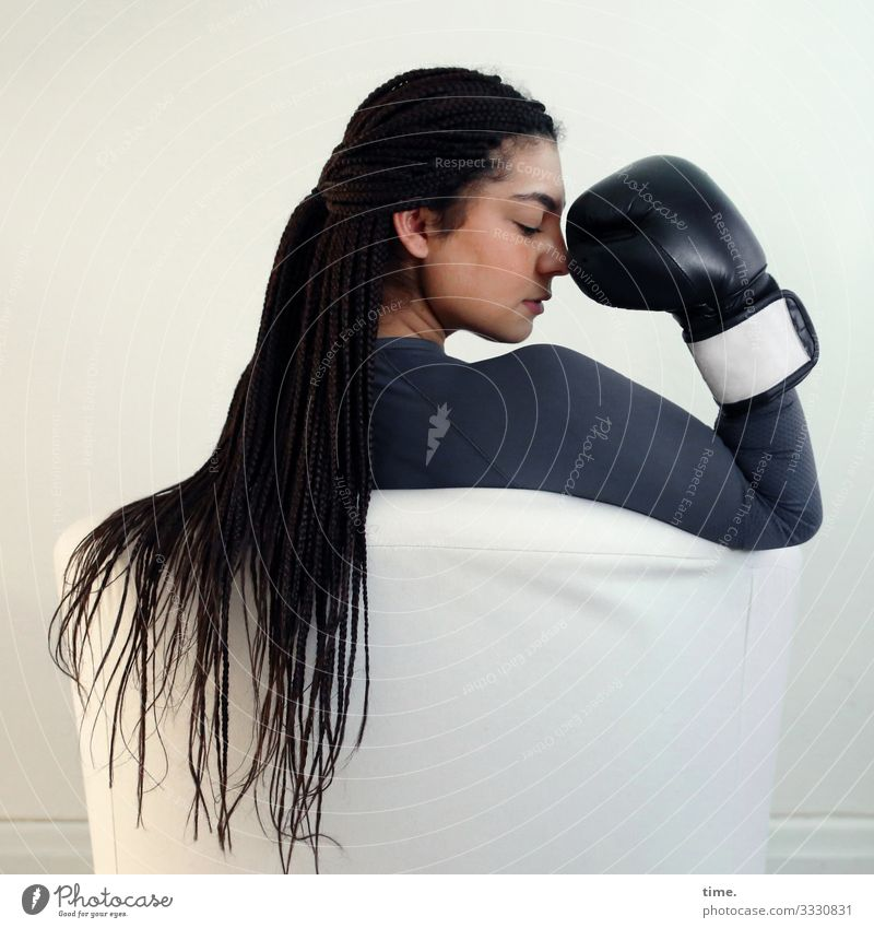 Nikoliya Armchair Boxing glove Feminine Woman Adults 1 Human being T-shirt brunette Long-haired Think Sit Willpower Passion Watchfulness Conscientiously Patient