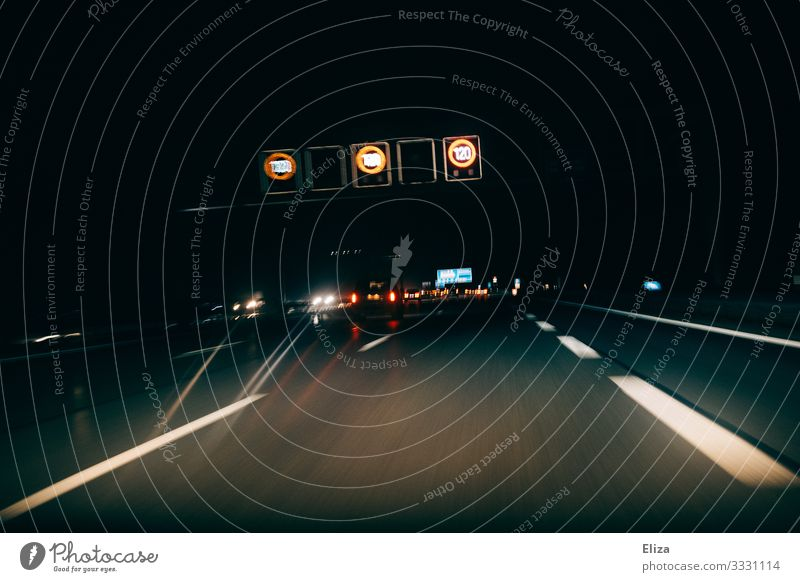 Motorway with cars and signs for speed limits at night in the dark Transport Means of transport Passenger traffic Road traffic Motoring Street Highway Car