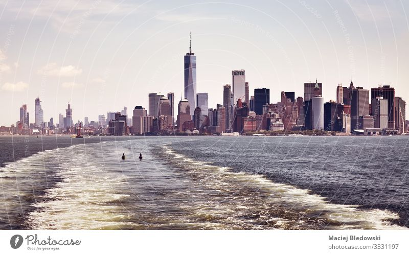 Color toned panoramic view of Manhattan skyline, New York. Vacation & Travel Tourism Trip Sightseeing City trip Summer vacation Sky River Town Downtown Skyline