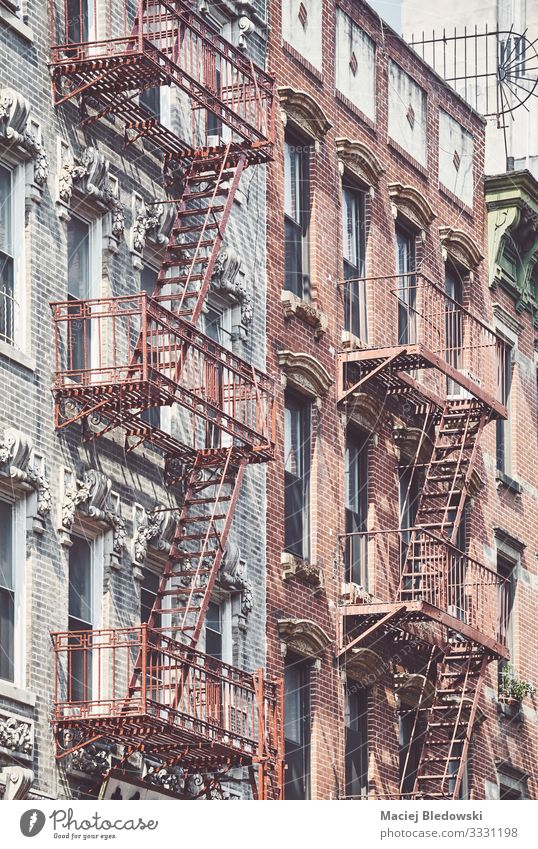 Manhattan old residential buildings with fire escapes, New York. Sightseeing City trip Living or residing Flat (apartment) House (Residential Structure)