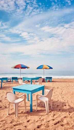 Tables and chairs on a tropical beach. Exotic Relaxation Vacation & Travel Tourism Trip Summer Summer vacation Beach Ocean Island Chair Restaurant Sand Sky