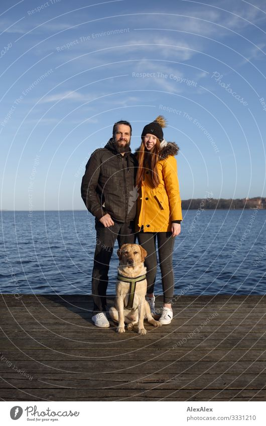 Couple with blond Labrador on jetty at the Baltic Sea Lifestyle Joy Happy Beautiful Harmonious Trip Ocean Young woman Youth (Young adults) Man Adults