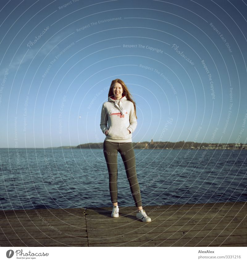 Young woman on a jetty at the Baltic Sea Lifestyle Joy Beautiful Harmonious Vacation & Travel Trip Youth (Young adults) 18 - 30 years Adults Landscape Autumn
