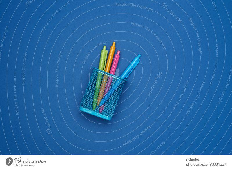 multi-colored plastic ball pens School Business Container Pen Metal Plastic Hip & trendy Blue Idea background Basket bin Conceptual design dispose equipment