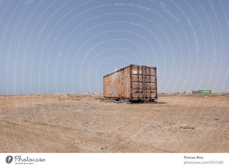 Discharged cargo Environment Drought Container Box Metal Steel Rust Old Stand Dirty Sharp-edged Dry Blue Brown Responsibility Conscientiously Curiosity