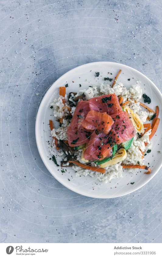 Tasty crumbly rice with salmon and vegetables on linen on table dish asian food meal poke fresh healthy fish appetizer tasty cuisine culinary gourmet raw snack
