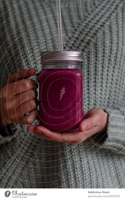 Person holding glass jug of delicious berry smoothie jar mix fresh healthy beverage vitamin detox fruit drink dessert shake straw food hand nutrient person