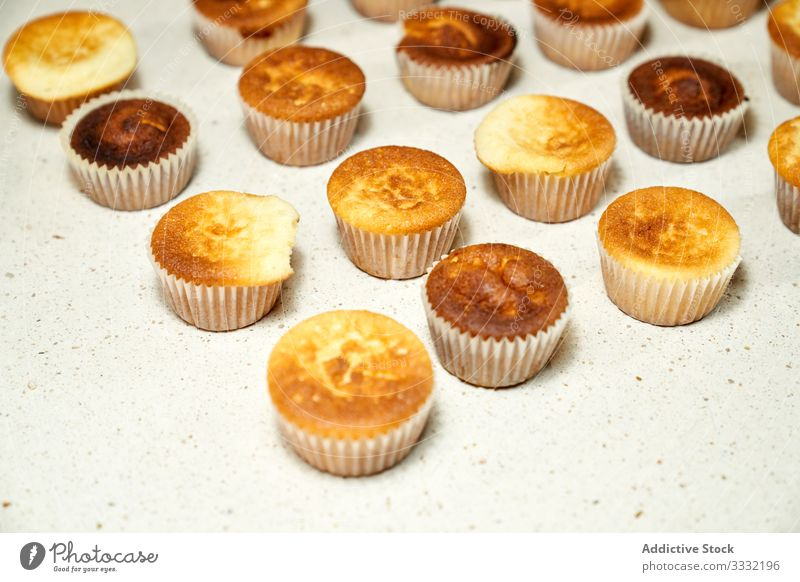 Group of toasted cupcakes in the oven baking calories baked fairy celebrate fattening frosted frosting creamy home muffins yummy homemade diet fresh gourmet