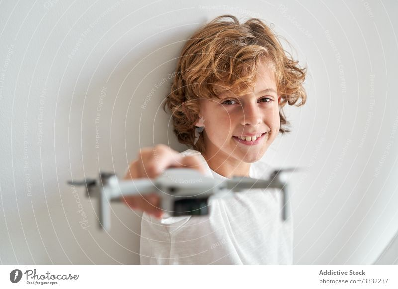 Child manipulating a drone and the remote control just given to him filming hobby robot motion aerial technology photography pilot discovery video sky operator