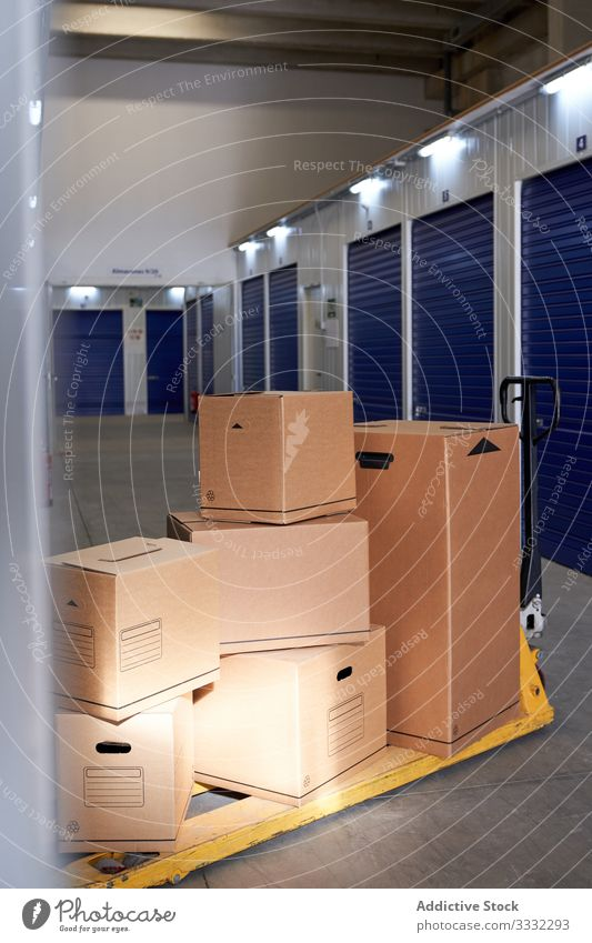 Self storage doors inside building padlock safety security box locker compartment cubicle blue protection rental warehouse business industrial unit store