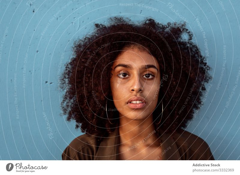 Young black woman looking at camera with intense look female sad portrait challenge african american young unhappy upset concerned despair frustration worry