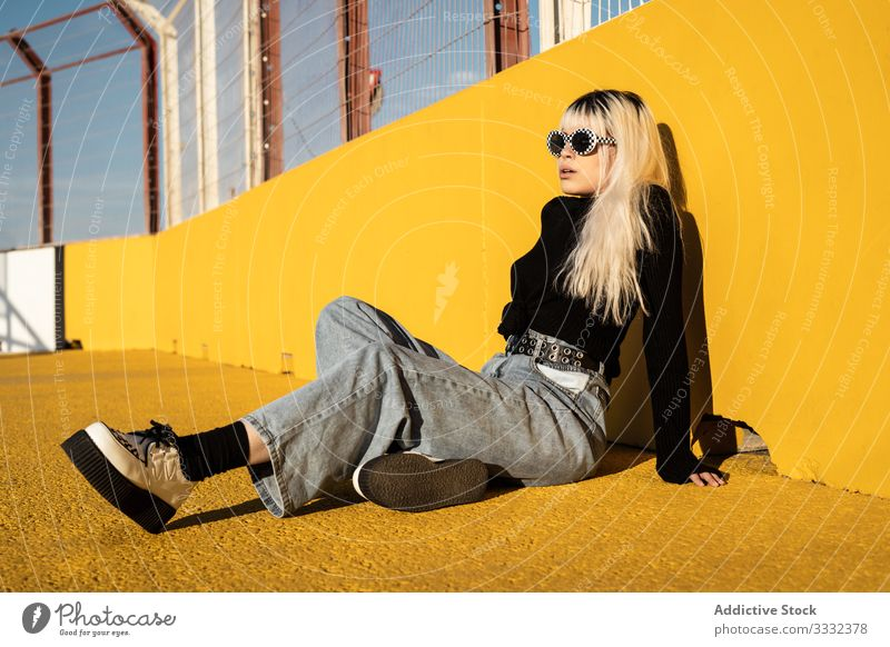 Calm young woman enjoying sunlight on stadium lay relaxation freedom carefree lifestyle female confident ground hipster colorful beauty individuality