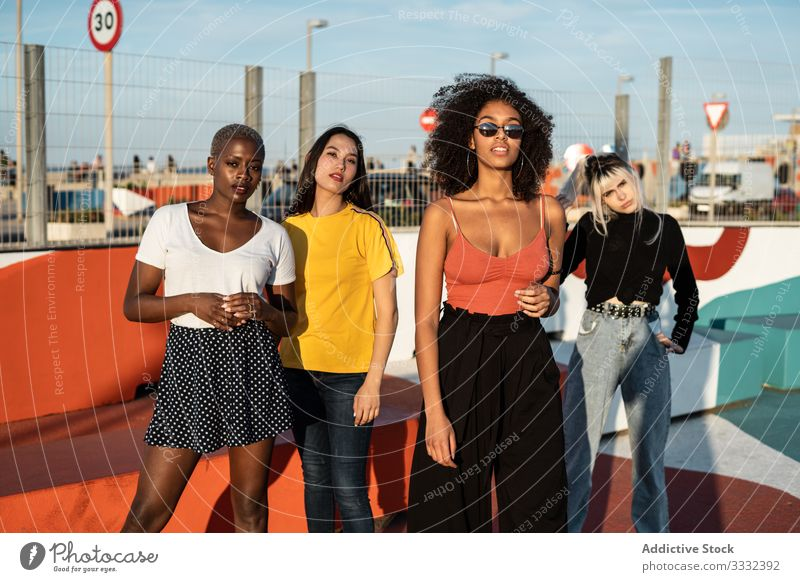 Confident young multiethnic female friends enjoying pastime in street woman fun meeting together lifestyle free time stadium student friendship freedom joyful