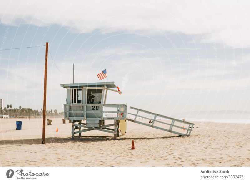 Lifeguard stand on sand beach lifeguard river relax view flag security tourism venice beach usa landscape travel day california architecture vacation america
