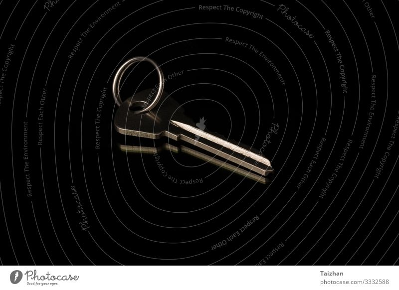chrome metal key on black background. Success Business Tool Ring Metal Authentic Dirty Above Black Safety Protection Safety (feeling of) estate Access close