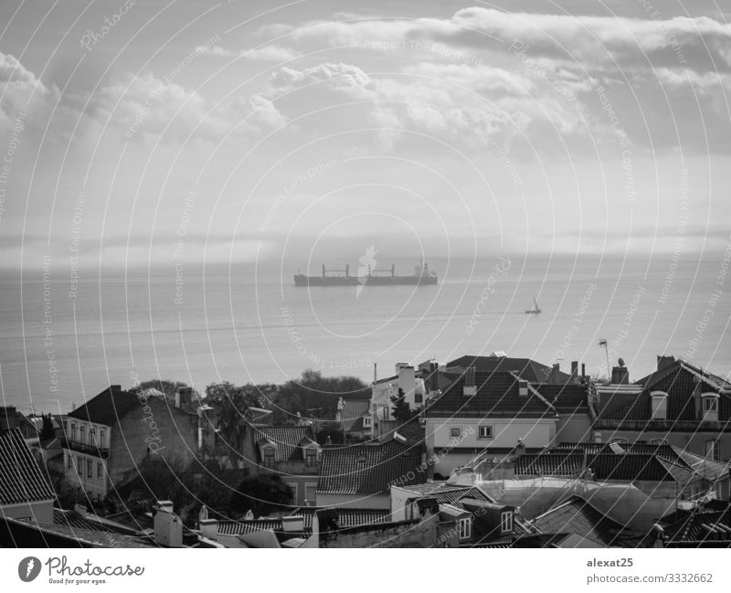 Ship in black and white Transport Navigation Container ship Sell City Black & white photo Landscape Lisbon Portugal no people sea Water Exterior shot