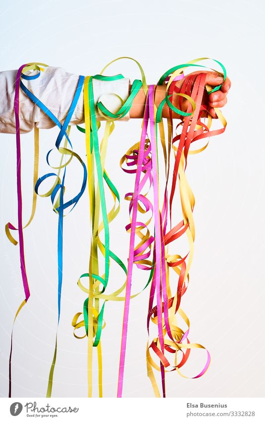 streamers Human being Feminine Child Girl Boy (child) Infancy Arm 1 String Paper streamers Hang Leisure and hobbies Carnival Colour photo Multicoloured