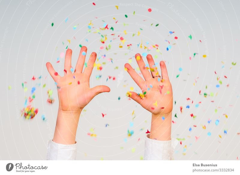 hands up Human being Feminine Child Girl Hand 1 8 - 13 years Infancy Party Birthday Confetti Emotions Joy Carnival Colour photo Studio shot Motion blur