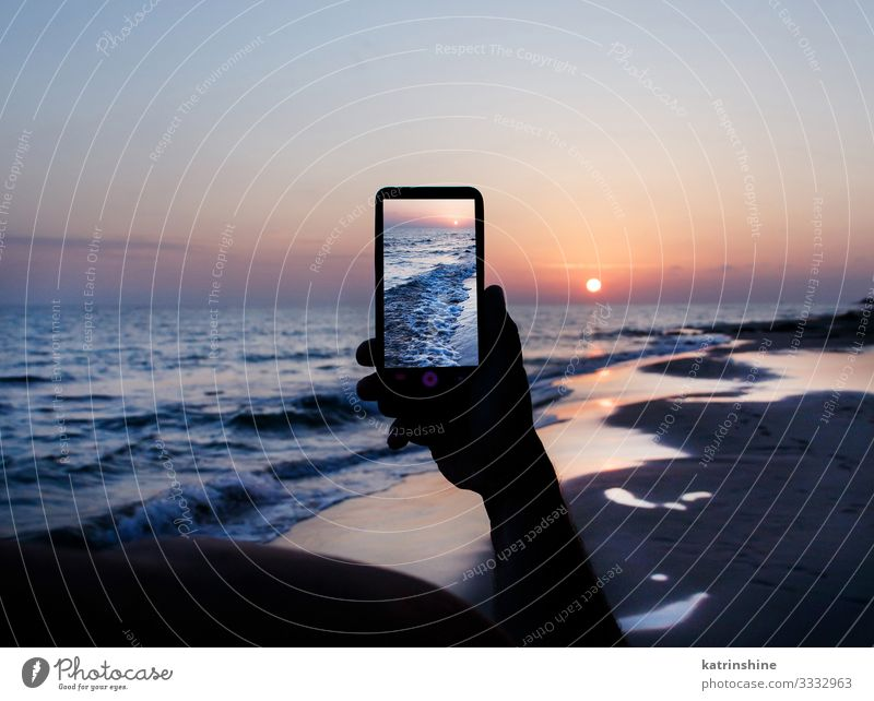 Man is taking a sunset photo on the cell phone Vacation & Travel Summer Beach Ocean Cellphone PDA Technology Adults Hand Environment Nature Landscape Sky Dark