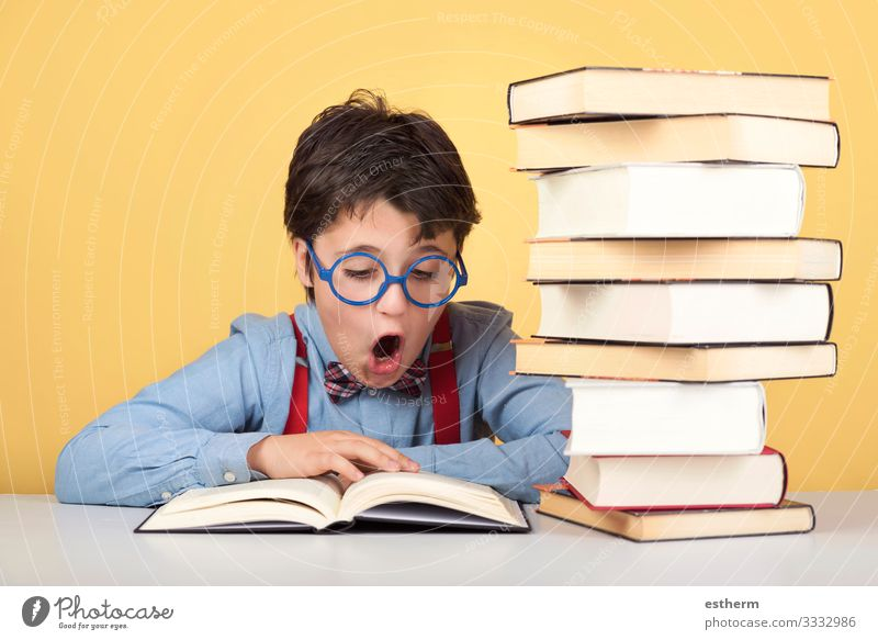 surprised boy reading a book Lifestyle Reading Child School Study Schoolchild Student University & College student Human being Masculine Boy (child) Infancy 1