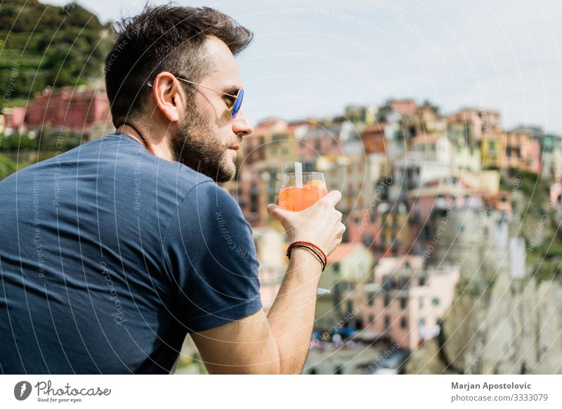 Young man drinking cocktail in village of Cinque Terre Drinking Juice Alcoholic drinks Longdrink Cocktail Lifestyle Joy Vacation & Travel Tourism Trip