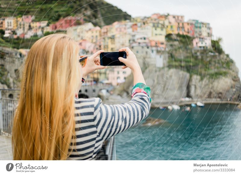 Young woman taking a photo of Cinque Terre Lifestyle Vacation & Travel Tourism Trip Sightseeing Cellphone Camera Technology Human being Feminine