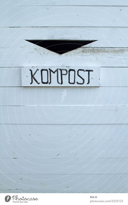 Compost lettering, on a sign of a waste container for waste separation on environmental protection and climate change. Trash composting Climate change