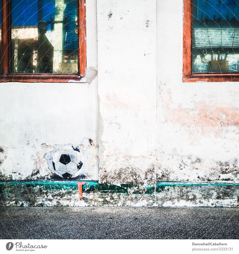 Football pictured on wall Foot ball Wall (building) Sports Ball Ball sports Leisure and hobbies Playing Football pitch Athletic Sporting event Wall (barrier)