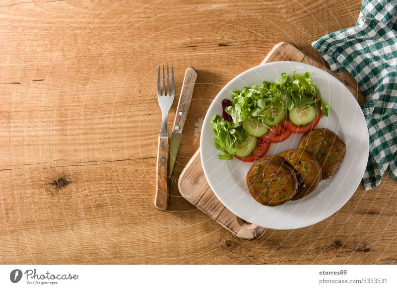 Seitan with vegetables on wooden table. Fake meat seitan Vegan diet Meat fake Alternative Food Healthy Eating Food photograph Vegetarian diet Protein Salad