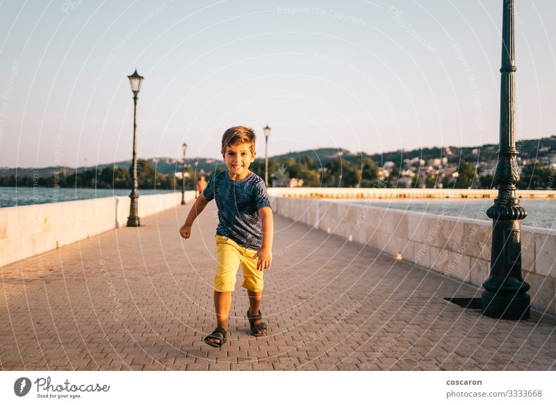 Athletic kid running on a bridge in Argostoli, Greece. Lifestyle Joy Happy Healthy Leisure and hobbies Playing Vacation & Travel Summer Beach Ocean Sports
