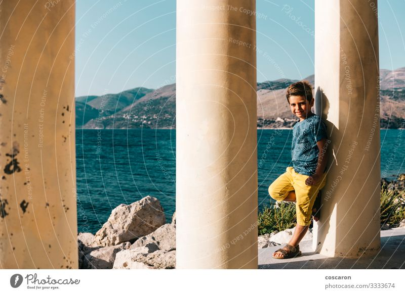 Little kid supported on a column near the sea Child Human being Sky Vacation & Travel Nature Summer Blue Beautiful White Ocean Joy Beach Architecture Lifestyle