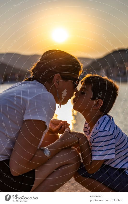 Mother and son looking each other at sunset Lifestyle Joy Happy Leisure and hobbies Playing Vacation & Travel Summer Sun Beach Ocean Mother's Day Child