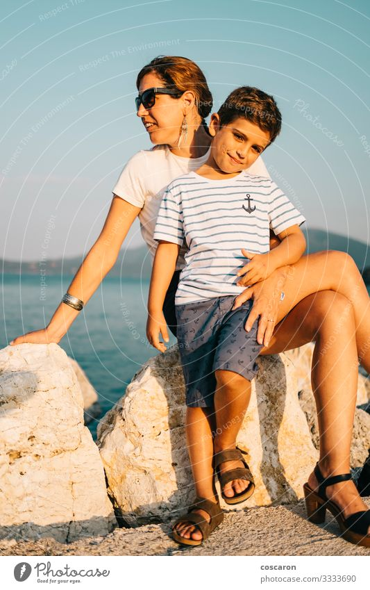 Mother and son enyoying relaxed looking the sea Woman Child Human being Vacation & Travel Nature Summer Beautiful Landscape Sun Ocean Relaxation Joy Beach