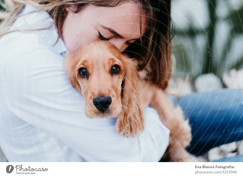 young woman and her cute puppy of cocker spaniel outdoors Woman Dog Pet Park Sunbeam Exterior shot Love Embrace Smiling Rear view Kissing Breed Purebred