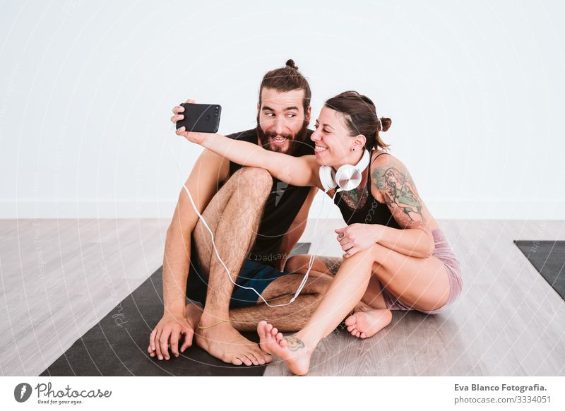 Two Friends At The Gym Taking A Selfie With Mobile Phone And Headset And Having Fun Sport And Technology Concept A Royalty Free Stock Photo From Photocase