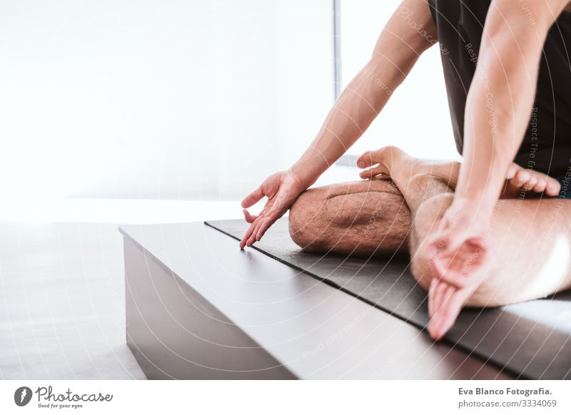 young man practicing yoga sport at the gym. Healthy lifestyle. close up view Yoga Man Boy (child) Sports Lifestyle Interior shot