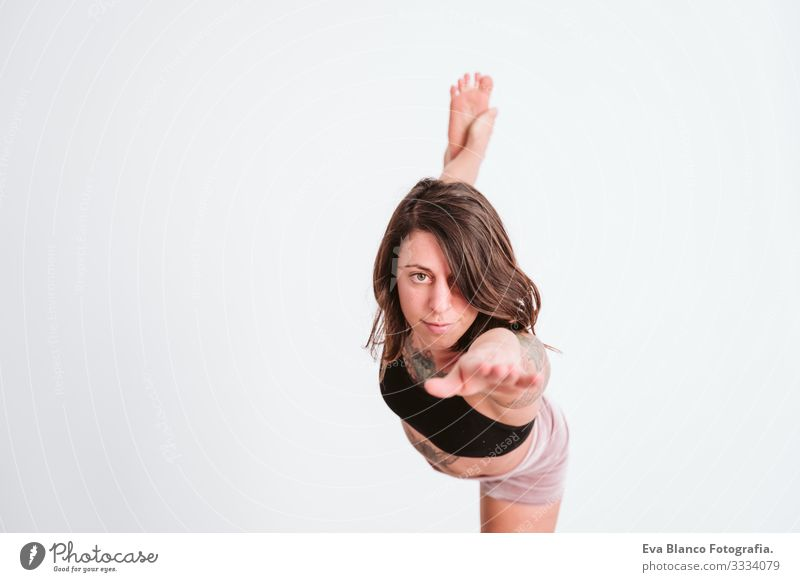 young tattooed woman practicing yoga sport at the gym. Healthy lifestyle Woman Youth (Young adults) Tattooed Yoga Sports Lifestyle
