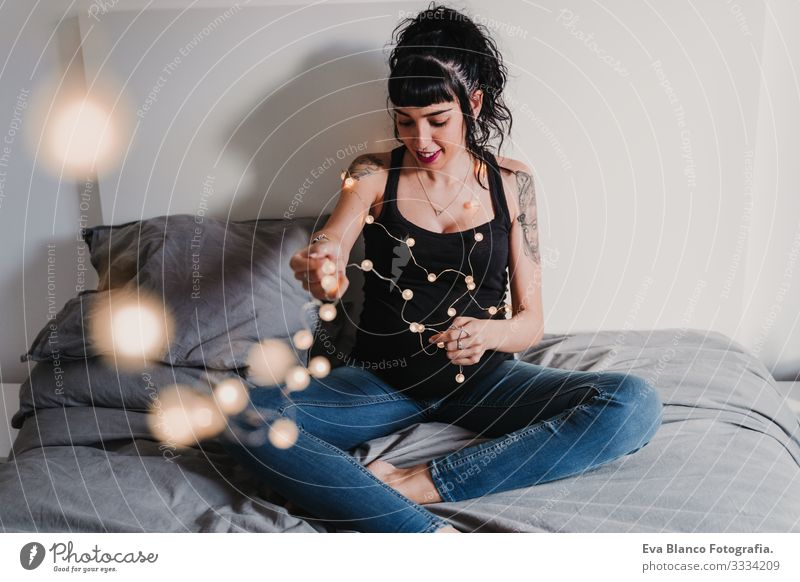 young pregnant woman at home working on laptop and drinking water Pregnant Woman Home Paper chain Light Christmas & Advent Smiling Happy Portrait photograph