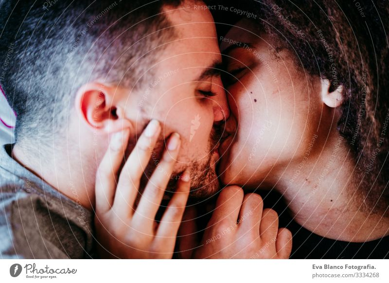 happy couple in love at home. Afro american woman and caucasian man. ethnic love concept Couple Love African-American Ethnic Woman Home Bed Interior shot
