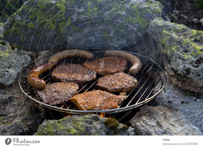 Open air grilling Food Meat Sausage Nutrition Dinner Eating Barbecue (apparatus) Barbecue (event) Meal Steak Meat-eater Exterior shot