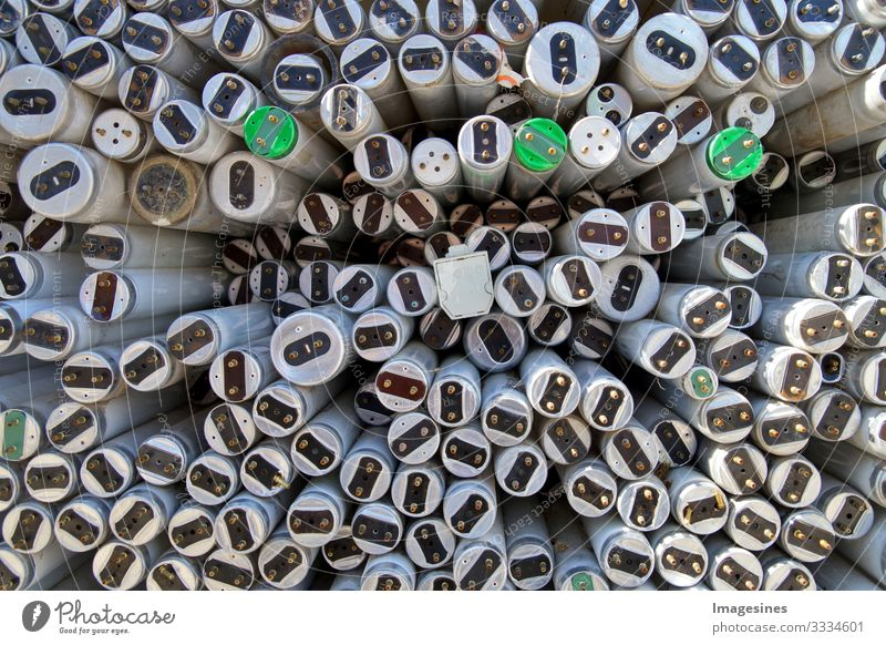 Old fluorescent tubes to be recycled. Disposal concept for old fluorescent tubes. Fluorescent substance Fluorescent Lights Lamp Energy industry Renewable energy