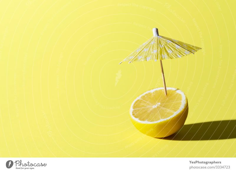 Lemon fruit and cocktail umbrella. Summer drink concept Food Fruit Breakfast Beverage Cold drink Healthy Eating Relaxation Fresh Funny Cute all yellow