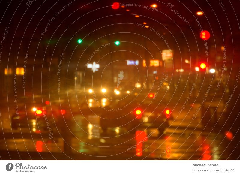 Evening in the rain in the city Storm Rain Transport Means of transport Road traffic Street Car Red Dangerous Stress Loud Confusing Colour photo Multicoloured