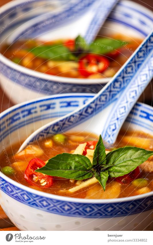 Chinese sweet-and-sour soup Meat Vegetable Soup Stew Herbs and spices Lunch Dinner Restaurant Hot Delicious Red Sour Kitchen Asian Meal Porcelain Spicy Mushroom