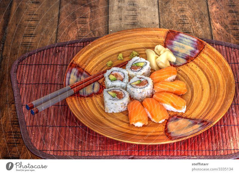 Salmon sushi rolls and sake with wasabi Food Fish Lunch Sushi Plate Healthy Eating Orange Rice wine salmon sushi raw fish Meal raw food Chopstick Wasabi ginger